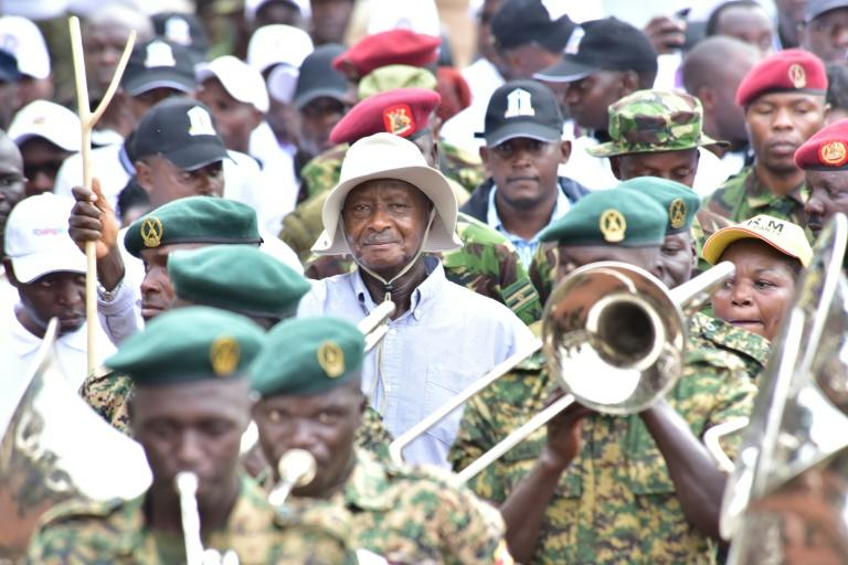 Museveni (C) led a march against corruption, but critics say he has done little to really tackle graft in his government (AFP Photo/Nicholas BAMULANZEKI)