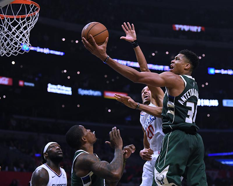LOS ANGELES, CALIFORNIA - NOVEMBER 06: Giannis Antetokounmpo #34 of the Milwaukee Bucks scores on a layup past Landry Shamet #20 of the LA Clippers during a 129-124 Bucks win at Staples Center on November 06, 2019 in Los Angeles, California. (Photo by Harry How/Getty Images) NOTE TO USER: User expressly acknowledges and agrees that, by downloading and or using this photograph, User is consenting to the terms and conditions of the Getty Images License Agreement.