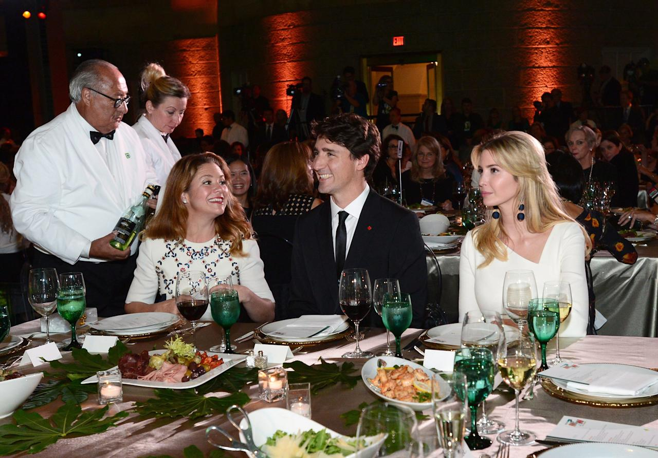 <p>Prime Minister Justin Trudeau, wife Sophie Gregoire Trudeau and Ivanka Trump look on during the Fortune Most Powerful Women Summit and Gala in Washington, D.C. Photo from CP Images </p>
