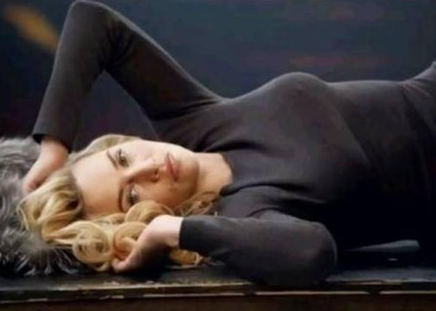 Celebrity advertising campaigns: Kate Winslet may be modeling St John knitwear but all we're really concerned with is how smoking hot she looks in this suggestive position.