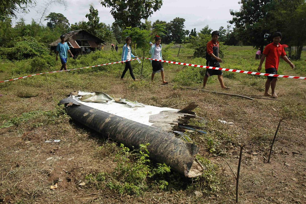 People arrive at the crash site of an ATR-72 turboprop plane, in Laos, near Pakse October 17, 2013. Bad weather is being blamed for the crash of a Laos Airlines plane which plunged into the Mekong river in southern Laos killing all 49 people on board, among them nationals of 10 countries. The plane flying from the capital Vientiane crashed at about 4.10 p.m. (10:10 a.m. BST) on Wednesday just eight km (five miles) short of its destination Pakse, which is near the borders of both Thailand and Cambodia. REUTERS/Chaiwat Subprasom (LAOS - Tags: DISASTER TRANSPORT)