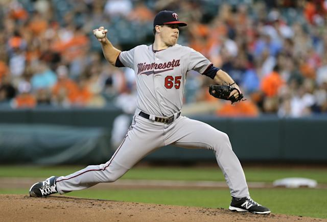 Minnesota Twins starting pitcher Trevor May throws to the Baltimore Orioles in the first inning of a baseball game, Friday, Aug. 29, 2014, in Baltimore. (AP Photo/Patrick Semansky)
