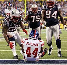Giants running back Ahmad Bradshaw falls into the end zone for the winning score