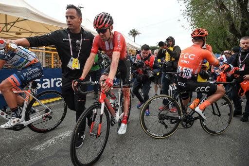 Dutch cyclist Tom Dumoulin, his left leg covered with blood following a crash, is assisted after completing the 4th stage of the Giro d'Italia, tour of Italy cycling race, from Orbetello to Frascati, Tuesday, May 14, 2019. Richard Carapaz of Ecuador sprinted to victory in the fourth stage of the Giro d'Italia on Tuesday, while Slovenian cyclist Primoz Roglic kept the overall lead after avoiding a crash toward the end of the route. (Alessandro Di Meo/ANSA via AP)