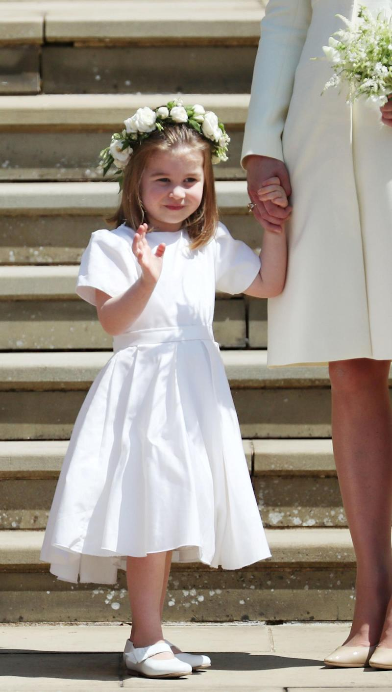 Princess Charlotte waves to crowds on the steps of St George's Chapel (REUTERS)