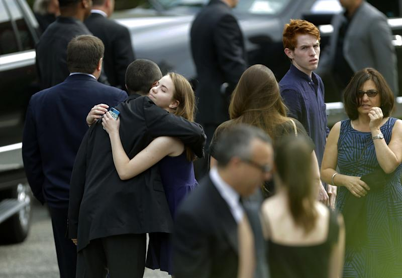 """Mouners arrive at Robert Spearing Funeral Home for a private viewing for actor James Gandolfini, Wednesday, June 26, 2013, in Park Ridge, N.J. Gandolfini, who played Tony Soprano in the HBO show """"The Sopranos"""", died while vacationing in Italy last week. (AP Photo/Julio Cortez)"""