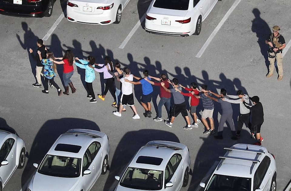 <p>People are brought out of the Marjory Stoneman Douglas High School after a shooting at the school that reportedly killed and injured multiple people on February 14, 2018 in Parkland, Florida. </p> (Photo by Joe Raedle/Getty Images)