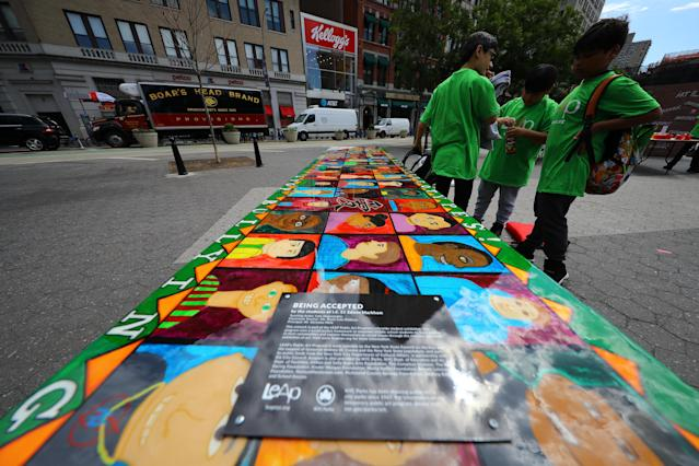 "<p>Students stand next to the ""Being accepted"" table for the LEAP Public Art Program'€™s citywide exhibition in Union Square Park in New York City on June 5, 2018. (Photo: Gordon Donovan/Yahoo News) </p>"
