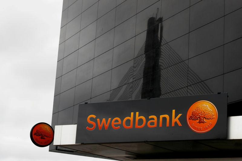 FILE PHOTO: Swedbank signs are seen on the bank's Latvian head office in Riga