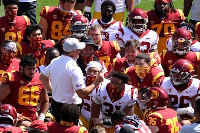 LOS ANGELES, CA - APRIL 17, 2021 - - USC's coach Clay Helton talks to players at the end of USC's Spring Football Game.
