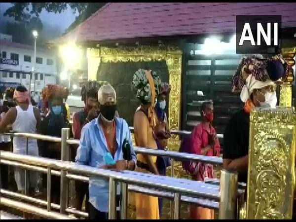 Devotees offer their prayers at the Sabarimala temple. (Photo/ANI)