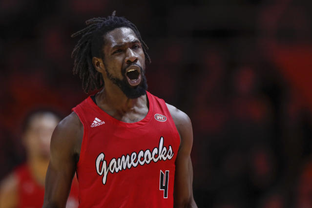 Jacksonville State guard Ty Hudson (4) reacts to hitting a 3-point shot during the first half of an NCAA college basketball game against Tennessee Saturday, Dec. 21, 2019, in Knoxville, Tenn. (AP Photo/Wade Payne)