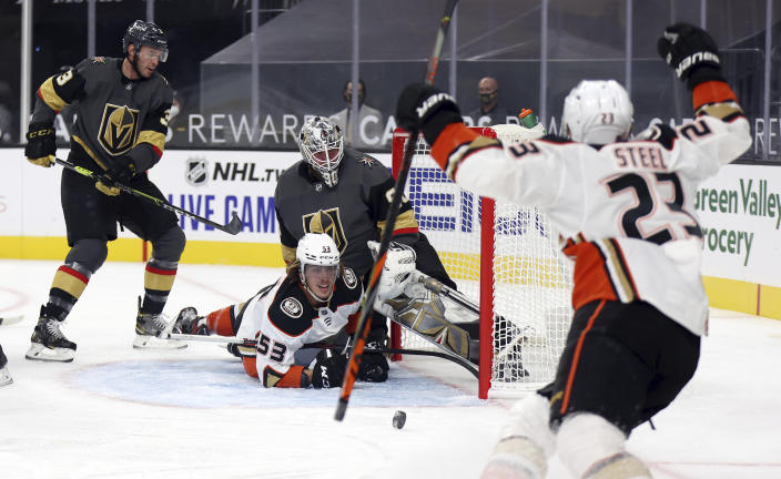 Anaheim Ducks left wing Max Comtois (53) looks up at center Sam Steel (23) after scoring against the Vegas Golden Knights during the first period of an NHL hockey game Thursday, Jan. 14, 2021, in Las Vegas. (AP Photo/Isaac Brekken)