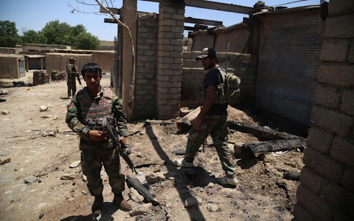 Afghan security officials patrol a village after they cleared the area of Taliban militants in Achin district of Nangarhar province - GHULAMULLAH HABIBI/EPA-EFE/Shutterstock