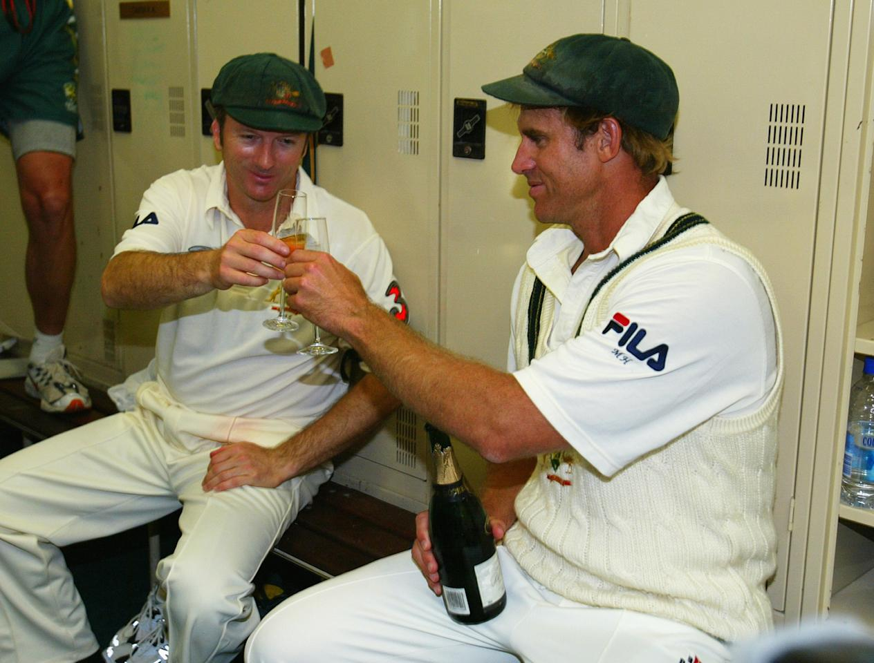 PERTH, AUSTRALIA - OCTOBER 10:  Matthew Hayden of Australia shares a glass of champagne with his captain Steve Waugh in the rooms after scoring 380 to break Brian Lara of The West Indies world record of 375 during day two of the First Test between Australia and Zimbabwe played at the WACA Ground on October 10, 2003 in Perth, Australia. (Photo by Hamish Blair/Getty Images)