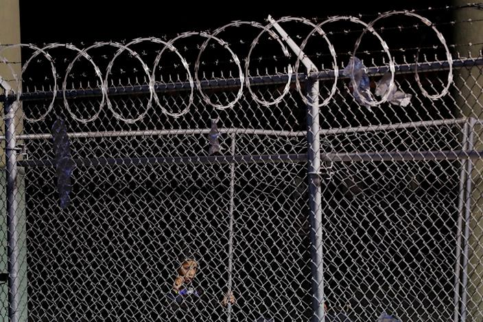 A young child looks through a fence inside an enclosure, where they are being held by U.S. Customs and Border Protection (CBP), after crossing the border between Mexico and the United States illegally and turning themselves in to request asylum, in El Paso, Texas, U.S., March 29, 2019. (Photo: Lucas Jackson/Reuters)