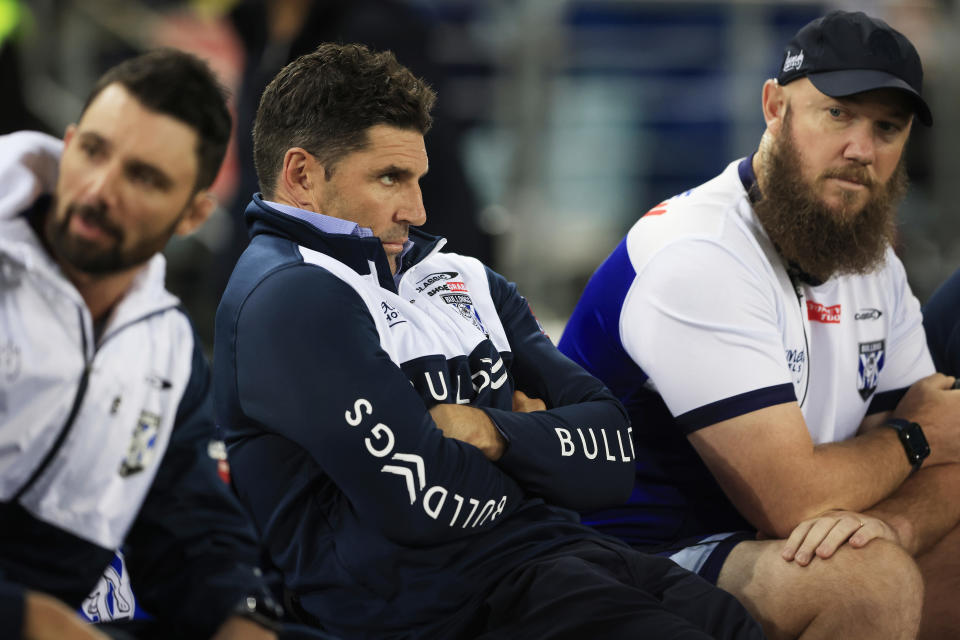 Bulldogs coach Trent Barrett (pictured middle) looks on during the round eight NRL match between the Canterbury Bulldogs and the Parramatta Eels.