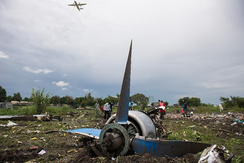 Dozens of passengers were illegally on board the An-12 cargo plane, which crashed into a farming community on an island in the White Nile river seconds after departure (AFP Photo/Charles Lomodong)