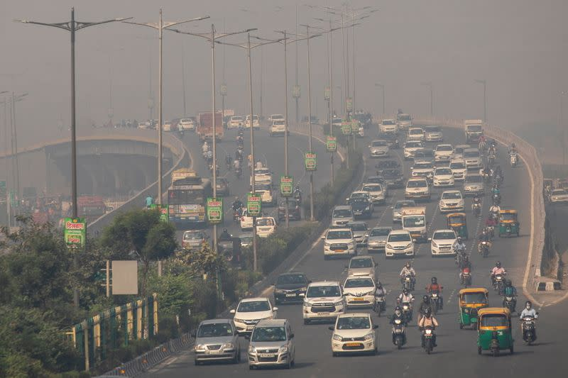 Traffic moves on a smoggy morning in New Delhi