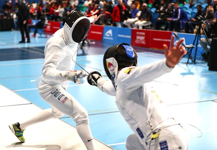 Alen Hadzic, left, fences Max Heinzer of Switzerland during the individual finals at the Peter Bakonyi Men's Epee World Cup in Richmond, Canada in 2020. (Devin Manky/Getty Images)