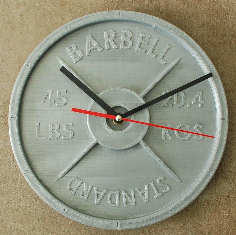 """<p>For telling time in your home or in your home gym, a CrossFitter would love to have this <a href=""""https://www.popsugar.com/buy/weight-plate-clock-513596?p_name=weight%20plate%20clock&retailer=etsy.com&pid=513596&price=43&evar1=fit%3Auk&evar9=46864615&evar98=https%3A%2F%2Fwww.popsugar.com%2Ffitness%2Fphoto-gallery%2F46864615%2Fimage%2F46867270%2FWeight-Plate-Clock&prop13=api&pdata=1"""" rel=""""nofollow"""" data-shoppable-link=""""1"""" target=""""_blank"""" class=""""ga-track"""" data-ga-category=""""Related"""" data-ga-label=""""https://www.etsy.com/listing/579478202/weight-plate-clock-customizable-3d?ga_order=most_relevant&amp;ga_search_type=all&amp;ga_view_type=gallery&amp;ga_search_query=crossfit&amp;ref=sr_gallery-1-7&amp;organic_search_click=1&amp;frs=1&amp;bes=1&amp;col=1"""" data-ga-action=""""In-Line Links"""">weight plate clock</a> ($43-$105) on their wall. </p>"""