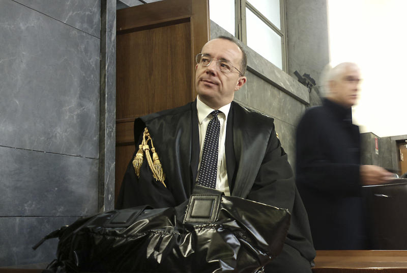 Prosecutor Antonio Sangermano arrives at the Milan court, Italy, Monday, March 11, 2013. Former Premier Silvio Berlusconi remains hospitalized with an eye inflammation that kept him from both his sex-for-hire trial and tax fraud appeal. Berlusconi's legal team has submitted petitions to courts in both cases requesting hearings be delayed due to the medical condition. Verdicts in both trials are due in the coming weeks, a politically sensitive time as Italy seeks to negotiate a stable government following inconclusive elections. (AP Photo/Antonio Calanni)