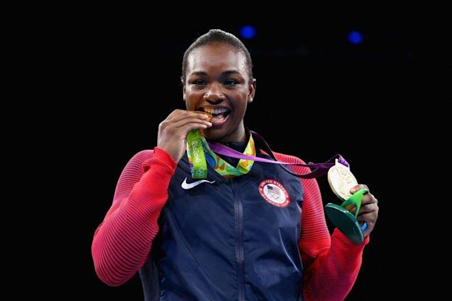 Claressa Shields shows off her two gold medals at the Rio Games. (Getty)