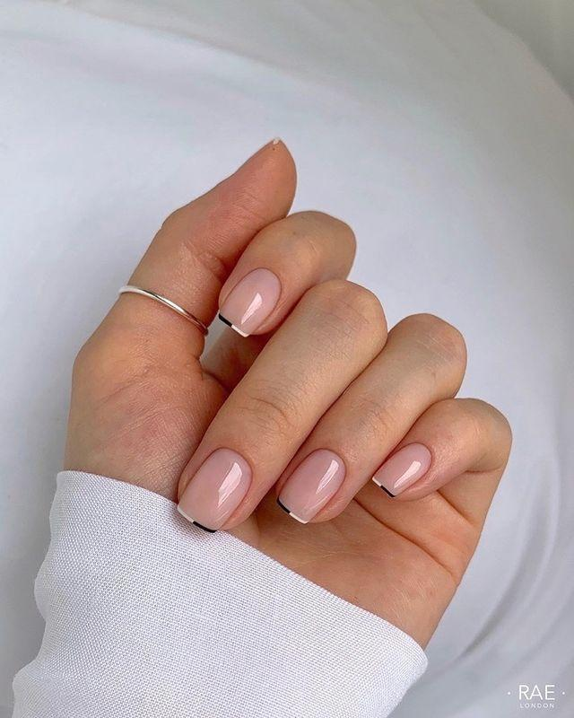 """<p>Does a line this thin still count as a <a href=""""https://www.cosmopolitan.com/style-beauty/beauty/g29760575/french-manicure-ideas/"""" rel=""""nofollow noopener"""" target=""""_blank"""" data-ylk=""""slk:French manicure"""" class=""""link rapid-noclick-resp"""">French manicure</a>? YUP. Use a <a href=""""https://prissybee.com/products/nail-art-brush-set"""" rel=""""nofollow noopener"""" target=""""_blank"""" data-ylk=""""slk:striper brush"""" class=""""link rapid-noclick-resp"""">striper brush</a> to get a super-duper thin line like this, but <strong>switch your shades halfway through</strong>.</p><p><a href=""""https://www.instagram.com/p/CF9_y1gjk39/?utm_source=ig_embed&utm_campaign=loading"""" rel=""""nofollow noopener"""" target=""""_blank"""" data-ylk=""""slk:See the original post on Instagram"""" class=""""link rapid-noclick-resp"""">See the original post on Instagram</a></p>"""
