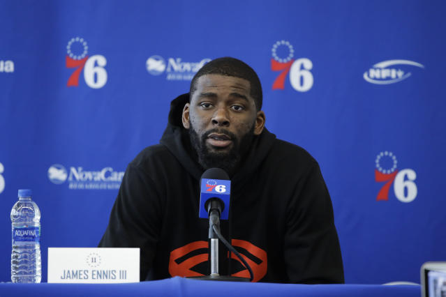 "<a class=""link rapid-noclick-resp"" href=""/nba/teams/philadelphia/"" data-ylk=""slk:Philadelphia 76ers"">Philadelphia 76ers</a>' <a class=""link rapid-noclick-resp"" href=""/nba/players/5220/"" data-ylk=""slk:James Ennis"">James Ennis</a> III speaks with members of the media during a news conference at the. (AP Photo/Matt Rourke)"