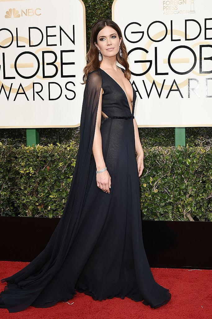 """Moore at the 2017 Golden Globes, in a sexy Naeem Khan frock with a plunging neckline and a cape. """"It was the year that the show was nominated and I was nominated. I felt like a superhero in my dress,"""" she says. (Photo: Getty Images)"""