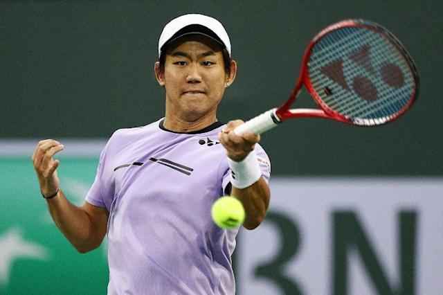 Japan's Yoshihito Nishioka holds on for a three-set victory over Canadian Felix Auger-Aliassime in the third round of the ATP Indian Wells Masters (AFP Photo/Yong Teck Lim)