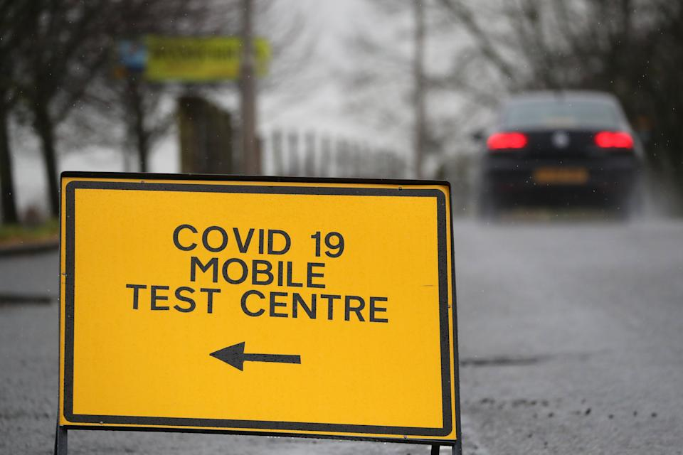 A general view of a Covid-19 mobile test centre sign at the entrance to Bannockburn High School near Stirling. Scotland is currently using a tier system to try and drive down coronavirus cases.