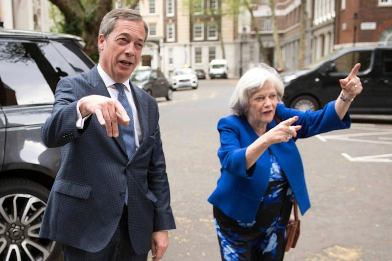 Leader of the Brexit Party Nigel Farage and former Conservative minister Ann Widdecombe, in London, Wednesday April 24, 2019. Ann Widdecombe has announced she is set to return to politics for the Brexit Party. (Stefan Rousseau/PA via AP)