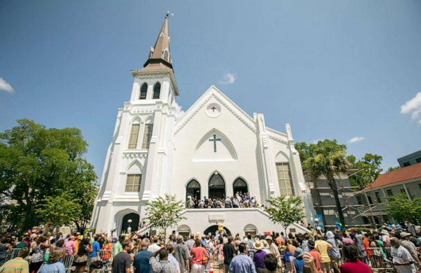 PHOTO: People stand outside as parishioners leave the Emanuel A.M.E. Church, Sunday, June 21, 2015, in Charleston, S.C. (Stephen B. Morton/AP)