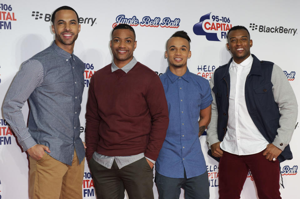 From left, Marvin Humes, JB, Aston Merrygold and Oritse Williams of JLS arrive for the Jingle Bell Ball in London, Saturday, Dec. 8, 2012. (Photo by Jonathan Short/Invision/AP)