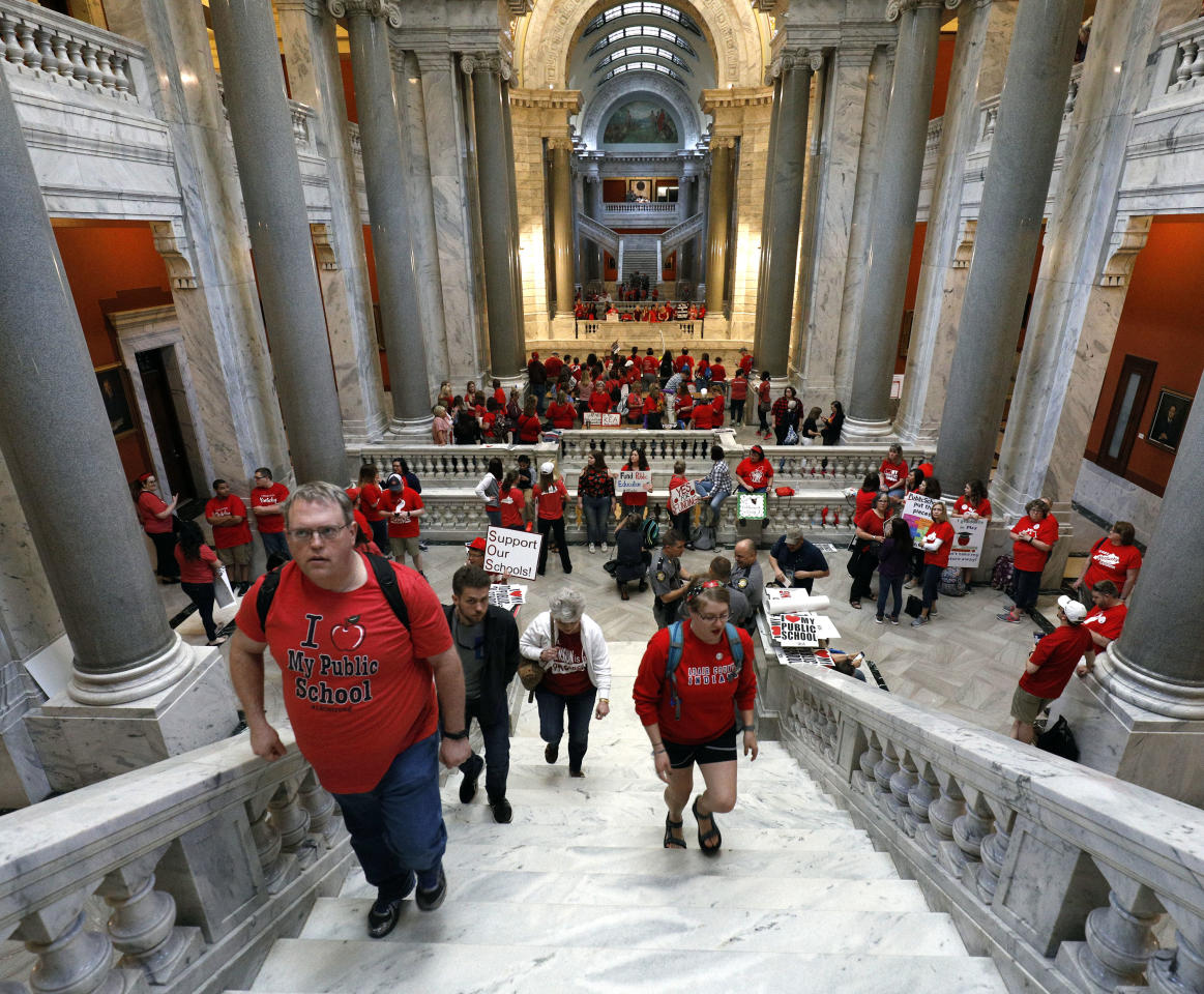 "<p>Kentucky Public school teachers rally for a ""day of action"" at the Kentucky State Capitol to try to pressure legislators to override Kentucky Governor Matt Bevin's recent veto of the state's tax and budget bills in Frankfort, Ky., April 13, 2018. (Photo: Bill Pugliano/Getty Images) </p>"