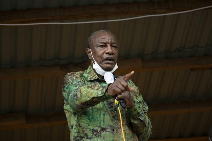 Many are divided over Guinea President Alpha Conde's economic successes before Sunday's vote