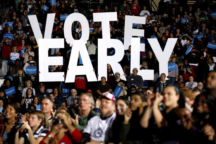 "A ""Vote early"" is seen at a rally for President Barack Obama in Youngstown, Ohio, in October 2012. (Photo: Matt Rourke/AP)"