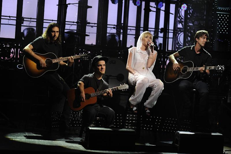 "This Oct. 5, 2013 photo released by NBC shows guest host Miley Cyrus performing during the late-night comedy series ""Saturday Night Live,"" in New York. (AP Photo/NBC, Dana Edelson)"