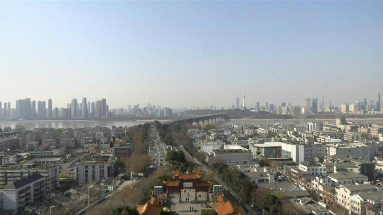 On the first day of 2021, residents of Wuhan express hope for the future in the Chinese city where Covid-19 first emerged