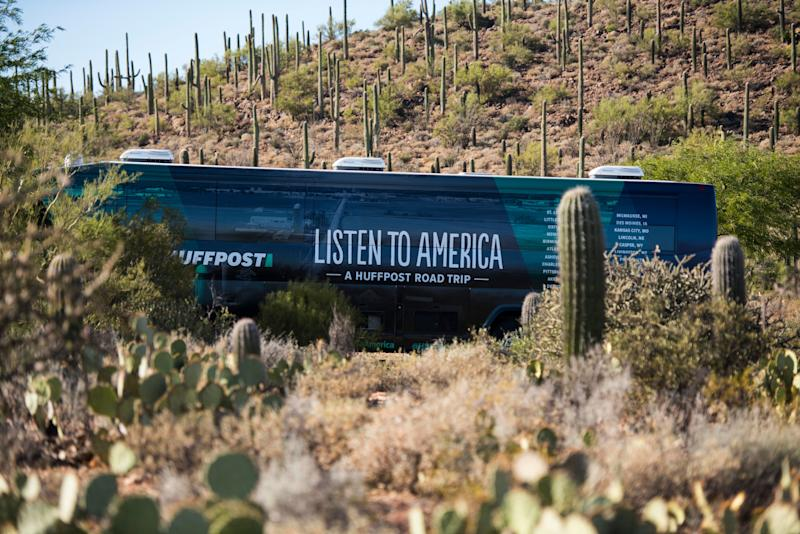 The HuffPost bus sitsamid cacti on the outskirts of Tucson.