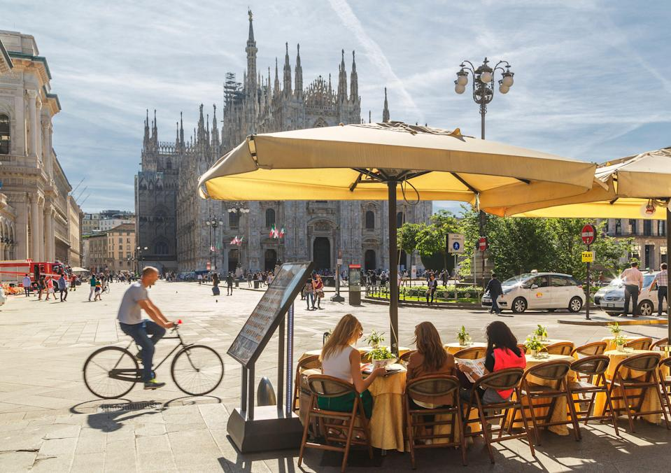 People sitting in a cafe facing the Cathedral (il Duomo) (Photo: Buena Vista Images via Getty Images)