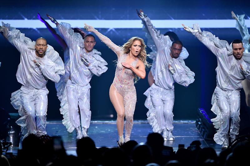 Jennifer Lopez and her dance crew look breath-taking as their hand movements are in sync for a performance