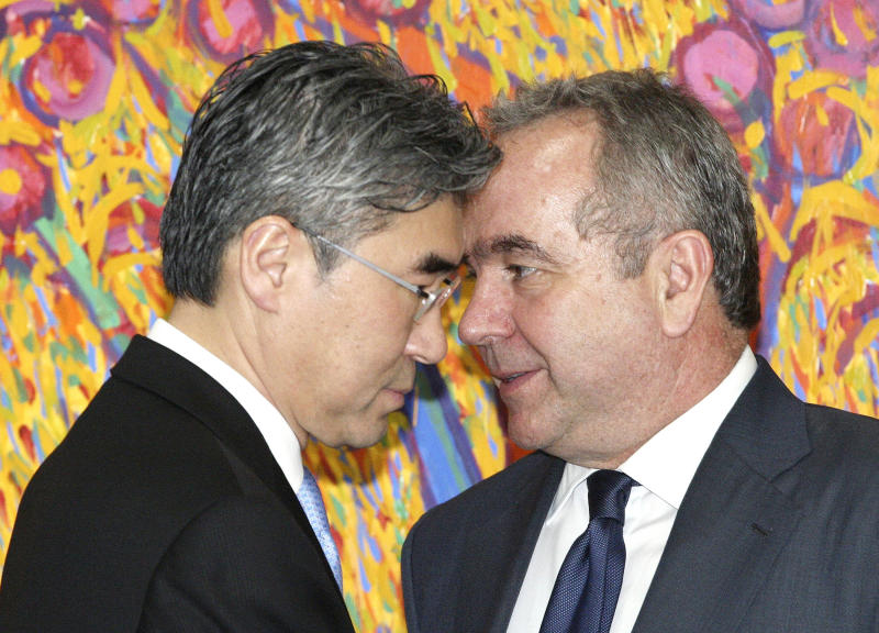 U.S. Assistant Secretary of State for East Asia and Pacific Affairs Kurt Campbell, right, talks with U.S. Ambassador to South Korea Sung Kim before meeting with South Korean Foreign Minister Kim Sung-hwan at the Foreign Ministry in Seoul, South Korea, Monday, April 16, 2012. (AP Photo/Ahn Young-joon, Pool)