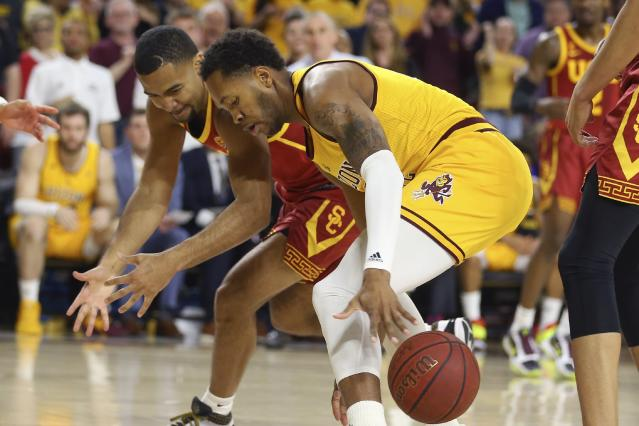 Arizona State forward Kimani Lawrence, front, steals the ball from Southern California guard Kyle Sturdivant, left, during the first half of an NCAA college basketball game Saturday, Feb. 8, 2020, in Tempe, Ariz. (AP Photo/Ross D. Franklin)