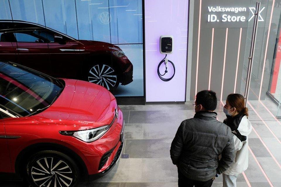 People check a Volkswagen ID.4 X electric vehicle displayed inside an ID. Store X showroom of SAIC Volkswagen in Chengdu, capital of southwest Sichuan province, on January 10, 2021. Photo: Reuters
