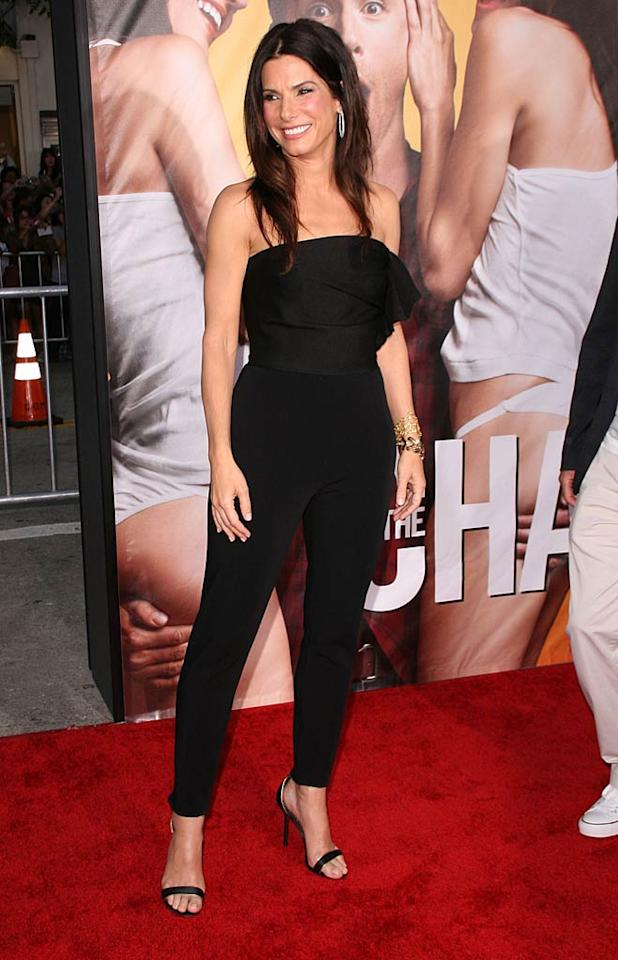 "Following in Olivia's footsteps was Oscar winner Sandra Bullock, who popped by the premiere to surprise her pal, Ryan Reynolds, who stars in the David Dobkin-directed comedy alongside Jason Bateman. What do you think of Sandy's strapless Lanvin jumpsuit? I happen to love it, as well as her strappy sandals, hoop earrings, and stacked bracelets. Amanda Leddy/<a href=""http://www.splashnewsonline.com"" target=""new"">Splash News</a> - August 1, 2011"