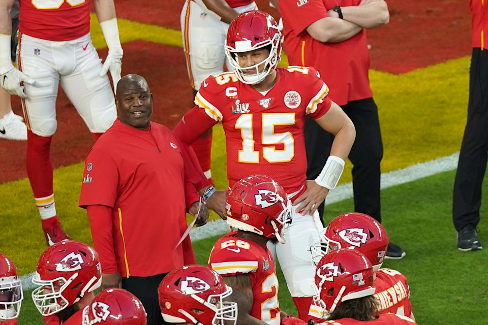 Kansas City Chiefs quarterback Patrick Mahomes talks with offensive coordinator Eric Bieniemy in game action during Super Bowl LIV.