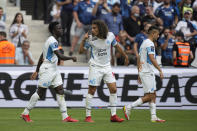 Marseille's Bamba Dieng, left, celebrates with his teammates after scoring his side's opening goal during the French League One soccer match between Marseille and Rennes at the Velodrome stadium in Marseille, France, Sunday, Sept. 19, 2021. (AP Photo/Daniel Cole)