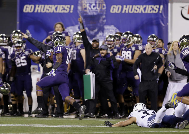 Washington's John Ross, left, returns a kickoff for a touchdown against BYU during first half of the Fight Hunger Bowl NCAA college football game Friday, Dec. 27, 2013, in San Francisco. (AP Photo/Marcio Jose Sanchez)